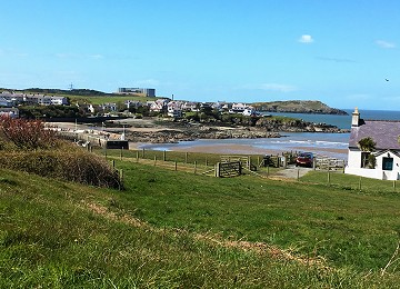 Cemaes bay from main road with Wylfa in background