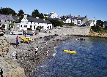 Children playing at Moelfre South beach