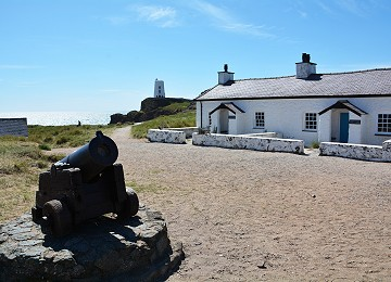 Old Pilot cottages and canon on Llanddwyn Island