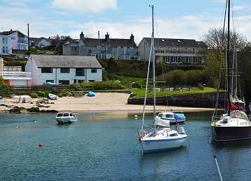 Mini beach and yachts in inner harbour at Cemaes bay