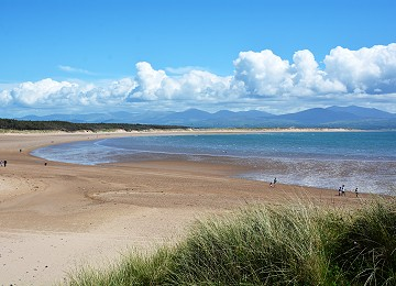 Newborough beach with Snowdonia in the distance