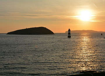 Puffin Island and Trwyn Du lighthouse sunrise