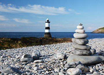 Stone stack and Trwyn Du lighthouse