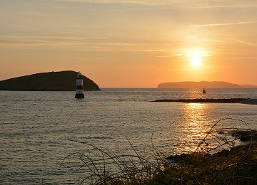 Trwyn Du lighthouse and Puffin Island at Sunrise