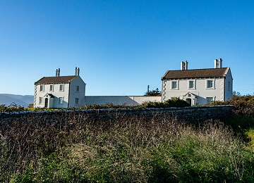 The two pilot houses once owned by Trinity house at Penmon Point